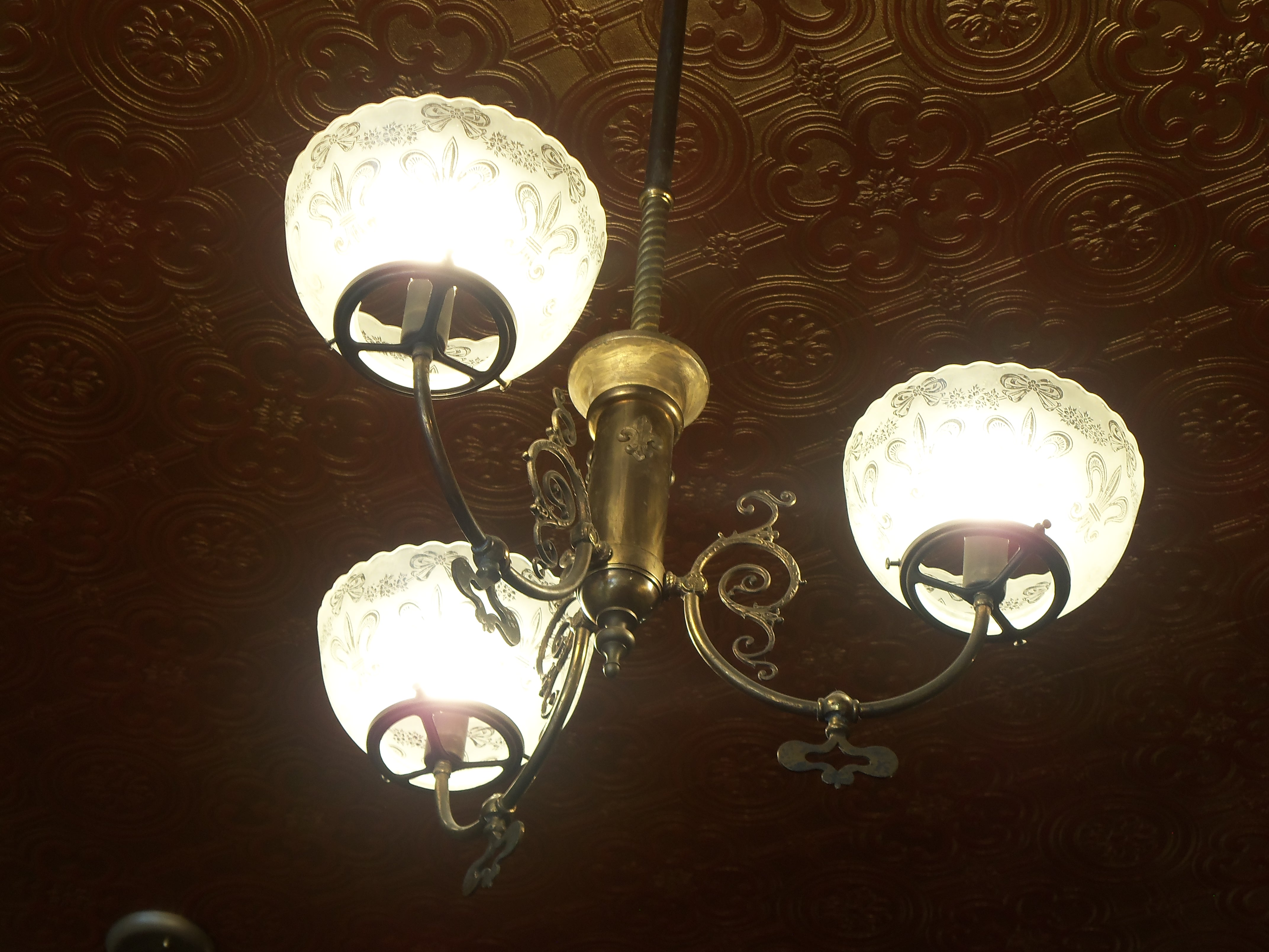 The Three Chandeliers Hanging From The Center Of The Room Were Originally Gas  Lamps From The 1880s That Were Later Converted To Electric.